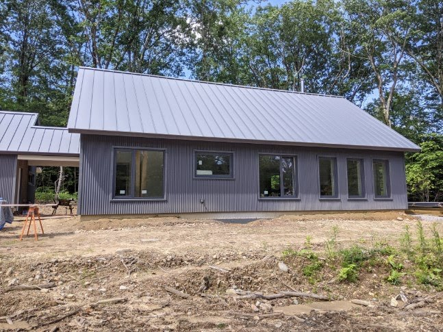 Just finishing up - custom garage, screened porch and breezeway added to base model